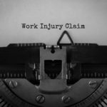 Text Work Injury Claim typed on retro typewriter